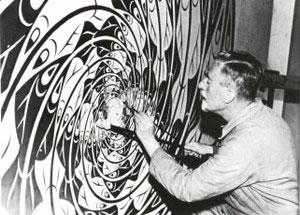 М.Эшер рисует свою знаменитую мозаику